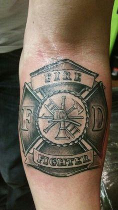 Maltese Firefighter cross tattoo forearm piece.