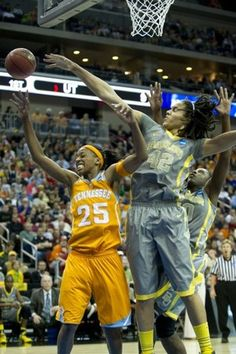 Baylor's Brittney Griner knocks the ball away from Tennessee's Glory Johnson in the final round of the Des Moines regional of the NCAA Women's Basketball Tournament at Wells Fargo Arena in Des Moines, IA on Monday, March 26, 2012.   (Photo by @Saul Young, News Sentinel)