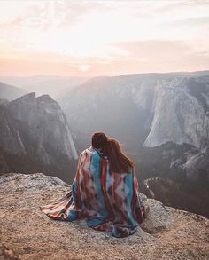 Couple blanket mountains view sky valley travel photo