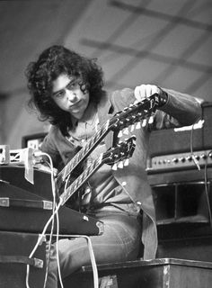 Jimmy Page tunes his guitar on stage during a soundcheck at Oude Rai on 27th May 1972 in Amsterdam, Netherlands.