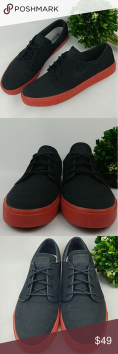 NIKE ZOOM STEFAN JANOSKI SB BLACK TERRA COTTA RED NIKE ZOOM STEFAN JANOSKI SB BLACK TERRA COTTA RED SHOES. Black canvas material with leather trim. In great gently used condition. Theres a few scuffs and stains on the soles. Size 13 31 cm Nike Shoes Sneakers