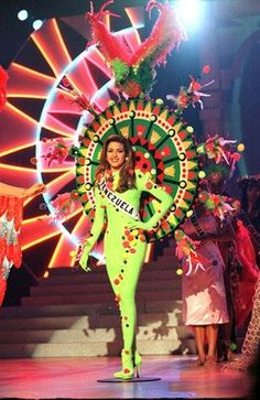 Miss Venezuela, Alicia Machado, during the Parade Of Nations of the Miss Universe Pageant of Miss Universe 1996, Miss Universe Costumes, World Winner, Miss Venezuela, Fairest Of Them All, Mardi Gras Costumes, Miss Usa, Funky Outfits, Beautiful Inside And Out