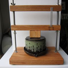 Oak and Stainless steel cheese press with ceramic mold. So great and so functional, following the tradition of centuries to press cheese in ceramic vessels!