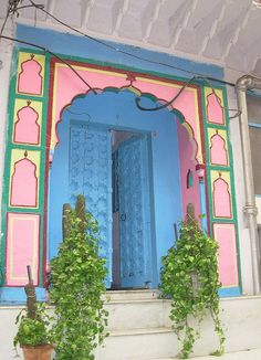 Blue, pink & yello carved doors in in Naughata, Old Delhi ~