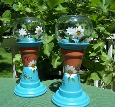 Clay pots and dishes combined with glass lanterns become adorable accessories for your porch, patio, sun room or just about anywhere! Daisies