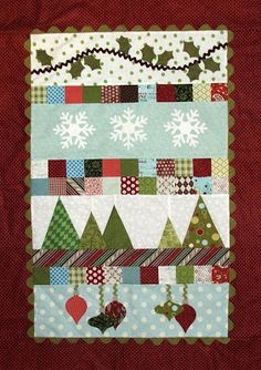 Deck The Walls Mini Quilt by Sandra Workman. Once you figure  outside dimensions  I think the rest would be easy to kind of do it yourself