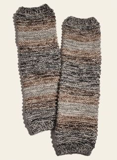 The cozy legwarmers are handknit in earthy tweeded stripes of an alpaca-blend yarn.