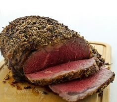 A tender and delicious Rib Eye Roast flavored with tri-color pepper, kosher salt, rosemary, thyme, and garlic for that special occasion. #holidaytable #ribeye