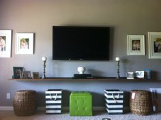 New living room entertainment center...hubby made the floating walnut shelf