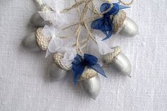 This listing is for 6 ornaments! These ornaments are made from natural red oak acorns with caps and adorned with organza ribbon bows. Acorns are 2-3 times hand-painted in Silver with acrylic paint, then varnished. Paint and glaze: water based, non-toxic. Hangers - linen twine in natural