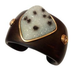 Spotted Drusy Quartz Rose Cut Diamond Ebony Cuff  USA  Modern  White Drusy quartz with random black speckles mounted in 18k yellow gold on a carved ebony cuff. The bracelet is further enhanced with a pair of bezel set, rose cut diamonds. The one-of-a-kind cuff is and original design by Michael Kneebone.  Price  $3,900