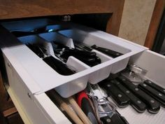 Plastic drawer organizer cut to overlap draw edges