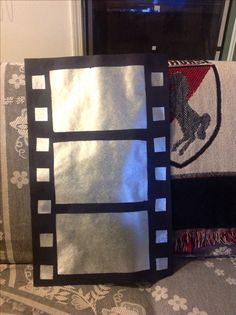 Made this decor for our family movie room from black poster board and silver gift wrap all from the Dollar Store.