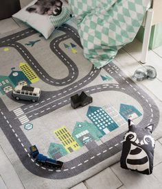 A grey and mint rug to decorate your boy's bedroom #kidsroom #rugs #kidsroomideas Find more inspirations at www.circu.net
