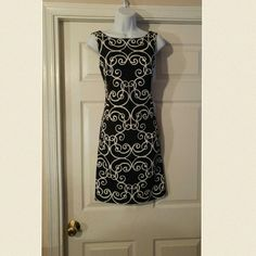 Black and white print  sleeveless sheath dress Beautiful Black &white print sleeveless sheath dress with high round neckline. dress has an acetate lining and is true to size. There is no extra give or spandex  to this dress and the size is missing from neck. But it measures around a size 6 Dresses
