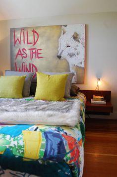 eclectic bedroom by Megan Buchanan...nice wolf art.