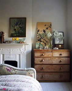 Lovely bedroom. I love the way things are displayed on that dresser!