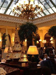 Cafe de la Paix, gourmet restaurant of the Intercontinental Grand Hotel Paris, with Ladurée macaroon trees at Christmas