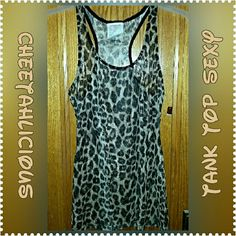 NEW Cheetahlicious Sexiness Racerback Tank Top If you want a wild look than this tank top is perfect for you. This cheetch print brown and tan racerback tank top is sheer but not see through. Has a light weight to it and will stand out . Its a junior XXL (19) it runs smaller! Im a womens plus size 22 and it fits tighter then i liked but still very pretty, wild and sexy. New never worn tired on reposh due to size. Best fit XL or large Xhilaration Tops Tank Tops