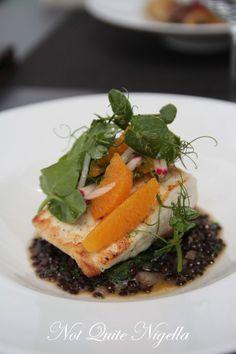 Baked whitefish, orange & radish salad, beluga lentils & verjuice nage