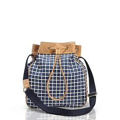 Tommy Hilfiger women's bag. Our one-size-fits-all drawstring pouch in a checkerboard print, just perfect for toting off-duty in style.<br/>•100% cotton.<br/>•Tote silhouette in canvas with faux leather trim.<br/>•Drawstring top, interior pockets, adjustable strap, gold-tone hardware.<br/>•Spot clean.<br/>•Imported.<br/>