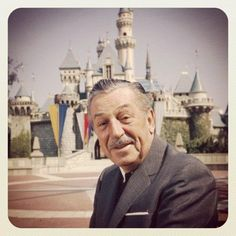Walt Disney in front of Sleeping Beauty Castle at Disneyland. About 1966.
