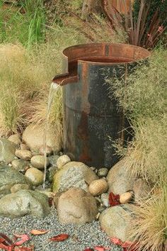 Industrial water feature; a different reuse of an oil barrel to the standard (but equally desirable) BBQ.