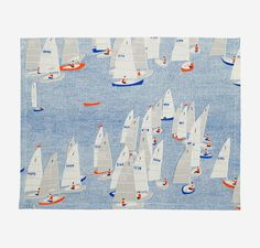 Regetta Placemats | Set the table with this set of 4 cotton linen placemats hand printed with our charming Regatta sail boat print. Get the full look with matching napkins and table runner.  From the Salcombe Collection