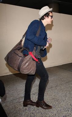 Harry arriving at LAX today. Why is he so attractive?!