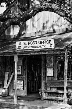"Luckenbach Texas BW - Joan Carroll  Luckenbach TX, It's quite famous as Hill Country things go and the ""town"" itself if known as a country music venue. But on a late autumn Tuesday afternoon, it's very sleepy.   Check out this photo and more at my website at joan-carroll.artistwebsites.com.  All works available as a print, canvas, greeting card, pillow cover, tote bag, shower curtain, or phone case.  Thanks!"