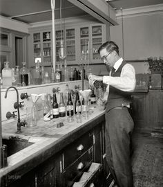 "Washington, D.C., circa 1920. ""U.S. Treasury, Internal Revenue Department."" Measuring the alcohol content of various libations and tonics at the start of Prohibition. National Photo Company Collection glass negative."