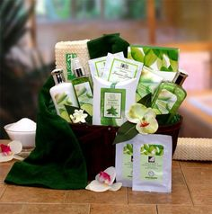 Gift Baskets Oxeme Gifts The All Natural Cucumber & Melon Calming Spa Bath & Body Gift Basket is a unique gift that offers wonderful treatments for body mind and soul This rich bamboo basket features all the necessities needed for a day of total soothing relaxation and pampering. We've included Jasmine green tea to calm their mind a revitalizing face mask nourishing hand cream and more. It's the total spa package in a rich keepsake bamboo caddy. These are full size 8 o...