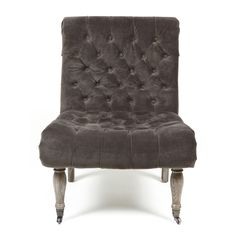 This accent chair features an oak construction with rayon velvet upholstery. The upholstery color is a charming warm grey.