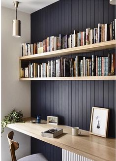Dark feature wall with natural wood shelving to highlight. beadboard panelling.