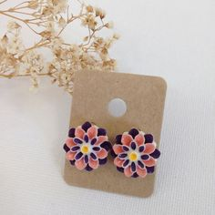 Pink & Purple Hand-Painted Flower Stud Earrings Cutie pink and purple flower stud earrings. Hand painted by me! Hypoallergenic bronze earrings studs and backings. Will come in a cute package, perfect for gifting! lilac & buttercup Jewelry Earrings