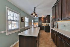 325 SUNNYSIDE AVE - Adam & Lisa Harrington | Northwest Indiana Real Estate | Dark Cabinets | Corian Countertop | Island | Commercial Faucet