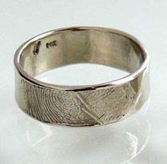 Fingerprint Wedding Bands - kind of a neat idea, as long as you know for sure it's your partner's fingerprints!