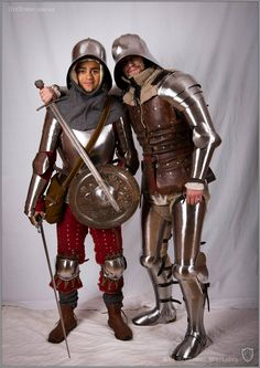 Great example of late transitional plate. On the right is a coat of plates with plate arms, legs, and sallet helmet. On the left a breatplate and what appers to be brigandine cuises.