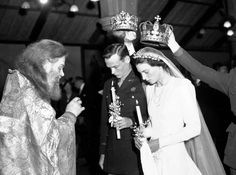 Ceremonial crowns are held over the heads of Russia's Princess Xenia Romanov and her groom U.S. First Lt. Calhoun Ancrum during their Russian Orthodox wedding as St. Philip's Church, London, June 17, 1945. The Princess is the only daughter of Russia's Prince Andrew and a grand-niece of the late Tsar Nicolas II. (AP Photo)