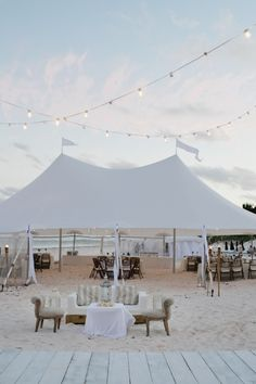 Obviously yours would be a lot smarter but if you did have to have a marquee, having sand under foot would be very cool!xx