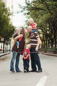 Fun family portrait pose - could get kids to cover their eyes