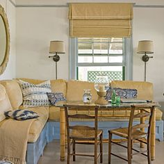 My beach home's kitchen nook~ Love the seating + fluffy cushions (storage beneath the cushions). But I'd use a bigger table!     10 Beautiful Beach Cottages | Durable Breakfast Nook | CoastalLiving.com