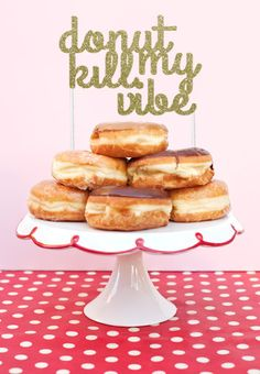 DONUT KILL MY VIBE - DONUT CAKE TOPPER  The perfect donut cake topper for any donut-themed party or National Donut Day (June 1st)!  The cake topper is hand crafted from premium quality glitter cardstock and attached onto two white lollipop sticks.  It is approximately 6 inches wide and 4 inches tall.  This cake topper can be made in any of the colours shown in the photo above (gold, silver, copper, etc.). Select your specifications and it will be made just for you!  All items are made to…