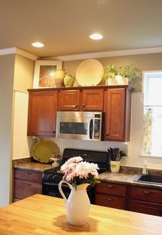 Decorating Tops Of Kitchen Cabinets decorate+above+kitchen+cabinets | home decor. decorating above the