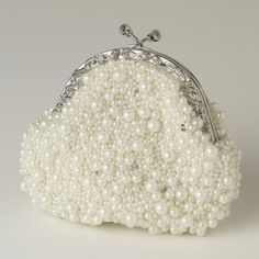 This fabulous faux ivory pearl and sequin handbag is glamorous and elegant!