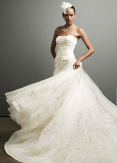 This tulle ball gown is the epitome of polished. World class construction and stunning details make this wedding gown unforgettable.   Strapless gown features eye-catching Gold-embroidered allover beaded lace.  Chapel train. Sizes 0-14. Available online.    Imported. Fully lined. Back zip. Dry clean.  To preserve your wedding dreams, try our Wedding Gown Preservation Kit.