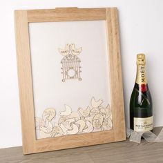 Personalised Drop Top Wedding Guest Book - Love Birds . An innovative way of allowing your wedding guests to leave you lovely messages on your day. Slot the adorable bird tokens in to the oak frame and read the notes as they collect at the bottom. Personalise it with the name of the couple on the two kissing 'love birds' at the top. A unique gift idea also. Available at gettingpersonal.co.uk - FAST UK DELIVERY