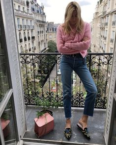 Count on a pink knit sweater to brighten up any winter wardrobe. Especially love the piece paired with embroidered mules