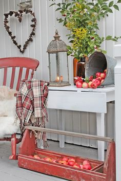 Fall ideas: Apples for the harvest season, a comfy chair with a cushion and a cover, and a lamp for the evening comes early VIBEKE DESIGN
