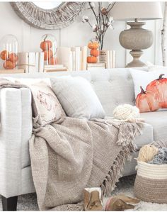 Love the pop of Pumpkins! And that little squirrel pillow, must have... this would switch out nicely with our fireplace room decor...